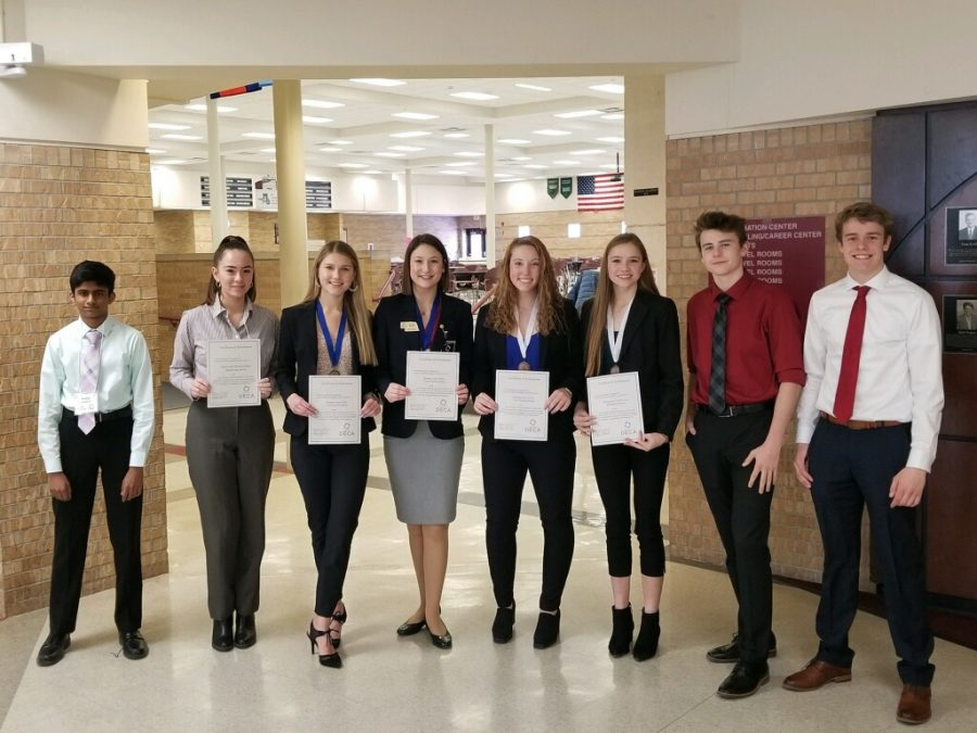 Elkhorn South students pose with awards from DECA Metros, held at Millard South on Jan. 16.