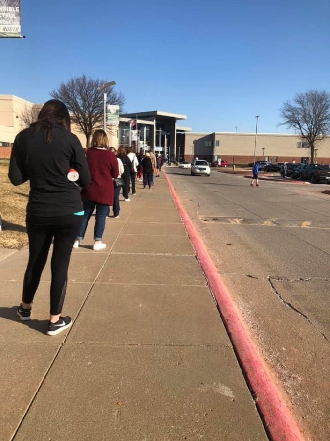 Teachers line up outside of Millard North High School prior to their 9am appointments. Photo credit by Kayla Anderson